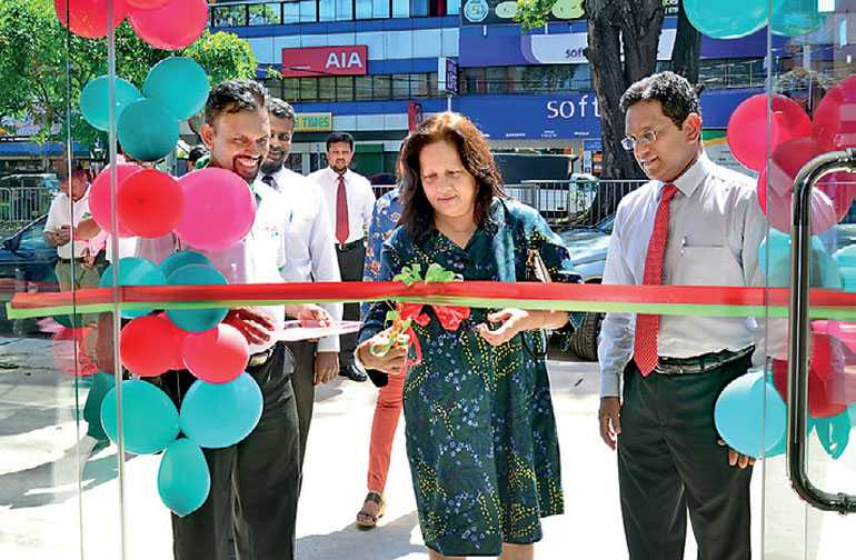 Hunter Co Managing Director L R P Dossa Ceremonial Cutting Of The Ribbon With General Manager Arketing Ruwan Singhabahu At New Showroom