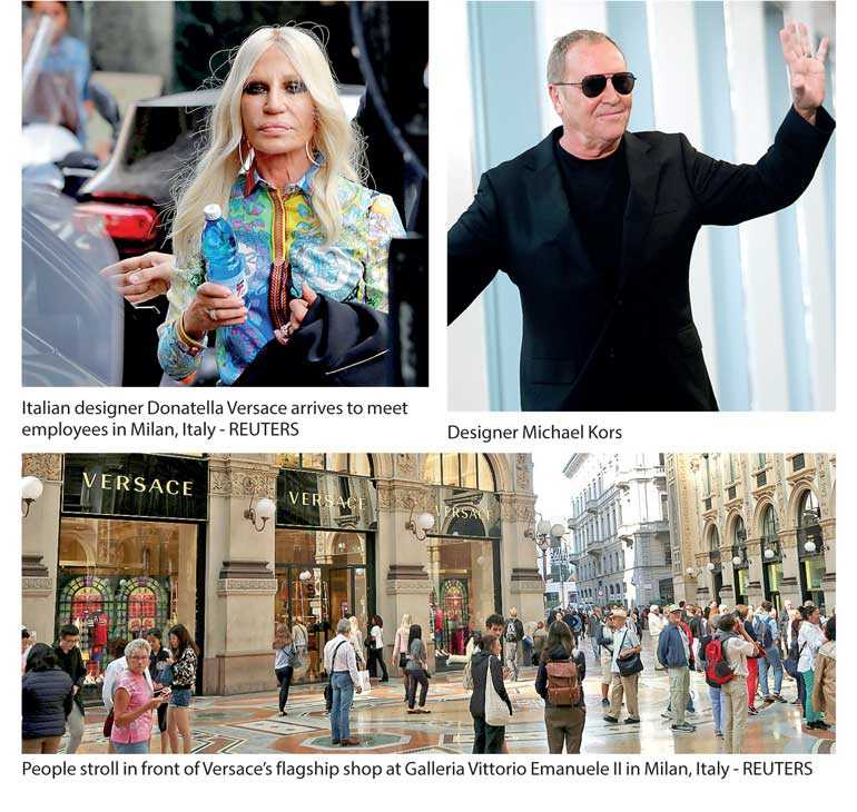 6f65af4faeb3 MILAN (Reuters)  US fashion group Michael Kors agreed to buy luxury  designer Versace for 1.83 billion euros including debt on Tuesday in the  latest foreign ...