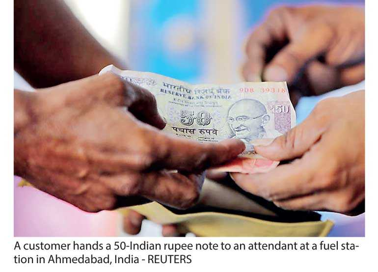 A tough road ahead for India's battered rupee: Reuters poll