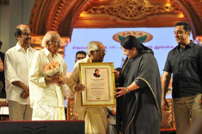 The-Chief-Minster-greets-the-recipients-of-the-award-MSV-and-TKR-as-Rajnikanth-and-Kamal-Haasan-look-on