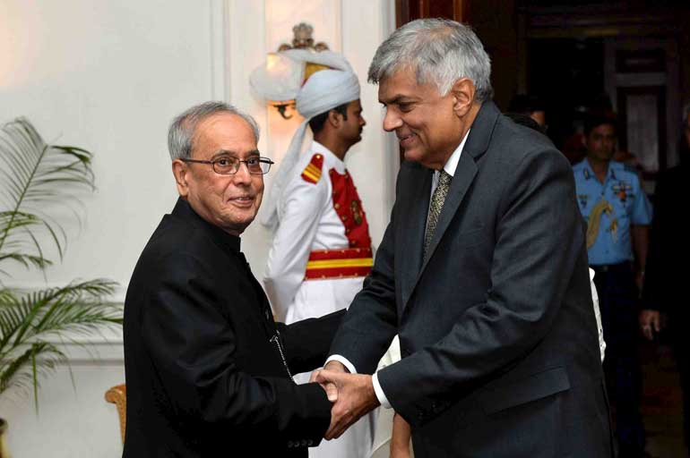 Sri Lanka's PM Wickremesinghe shakes hands with Indian President Mukherjee before their meeting in New Delhi