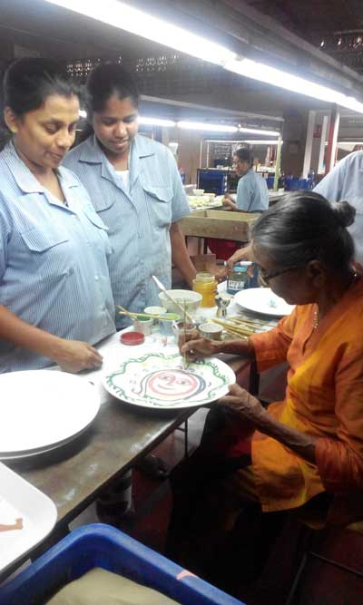 Sybil-learning-how-to-paint-on-ceramics-at-the-youthful-age-of-88