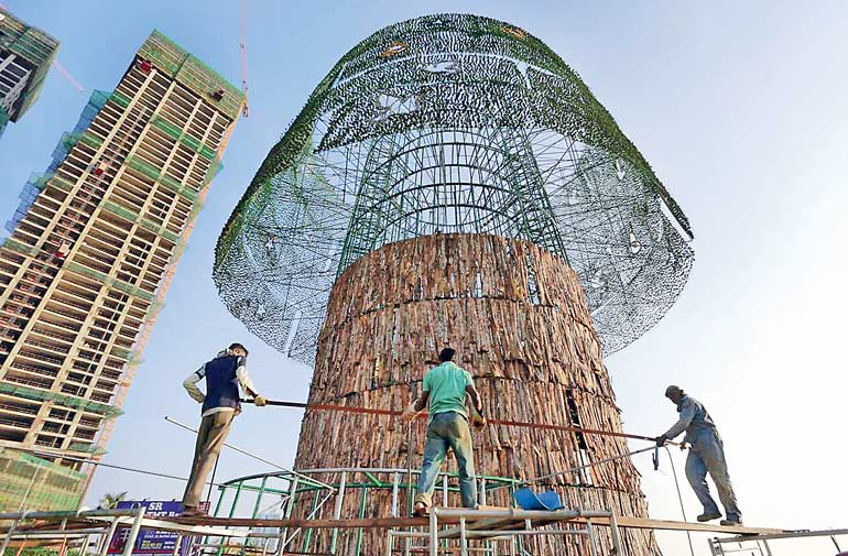 workers in mid december used steel rods in the construction of what aims to be a record breaking artificial christmas tree in colombo photo eranga - Worlds Tallest Christmas Tree