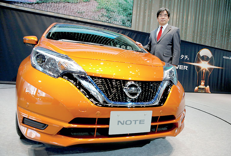 with new hybrid, nissan offers cheaper route to electric cars | ft
